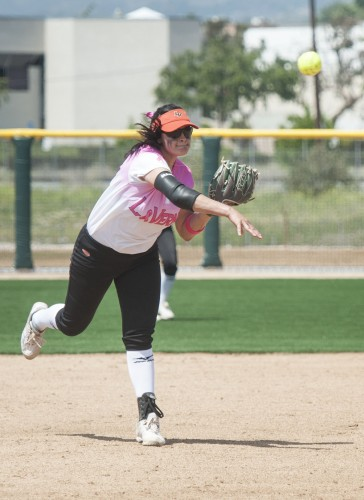During the ninth inning of the first game of Saturday's doubleheader, junior shortstop Rebecca Ireland makes the throw to first for an easy out. Donning pink breast cancer awareness jerseys, La Verne faced Claremont-Mudd-Scripps on Campus West's opening weekend. The Leopards split the doubleheader, winning the first game, 2-1, and losing the second, 11-4. / photo by Hunter Cole