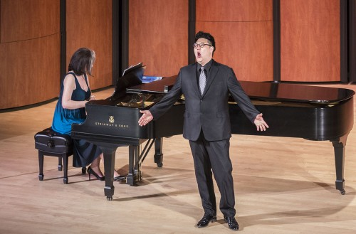"""Kihun Yoon, the only baritone from the group of five singing in Sunday's performance, presents the opening song. Pianist and head coach Nino Sanikidze summarized the numbers to give the audience context and background, as the opera songs were not in English. This performance of Sundays at the Morgan featured four other artists of the LA Opera's Domingo-Colburn-Stein Young Artists, all of which sang """"Libiamo ne' lieti calici"""" known as the """"Drinking Song"""" from La Traviata for the closing number. / photo by Helen Arase"""