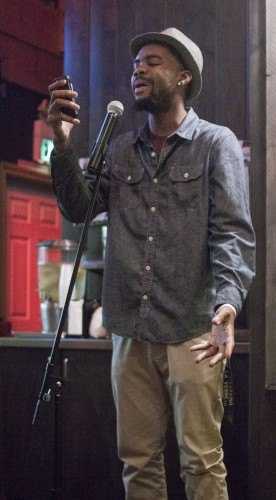 Senior liberal arts major Mathieu Koontz recited a poem at the spoken word plays open mike night on April 17. The club holds an open mic night one Thursday a month at Pappa's Artisanal, where anyone is welcome to sing, recite poetry, and in some cases even tell jokes.