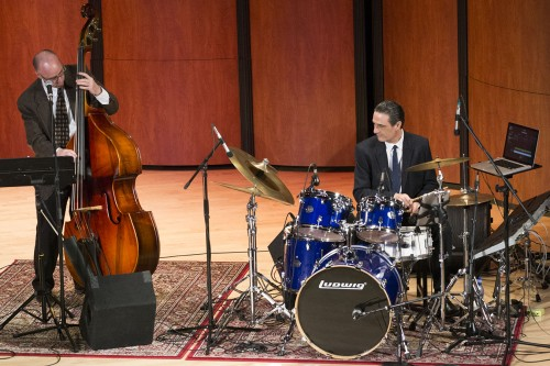 Ted Edeson and Steve Biondo play bass and drums for the jazz group OrganiZm in Morgan Auditorium. Gayle Serdan (not pictured) completed the trio on Hammond B3 Organ. Edeson, Biondo and Serdan all graduated from the University. / photo by Julian Burrell