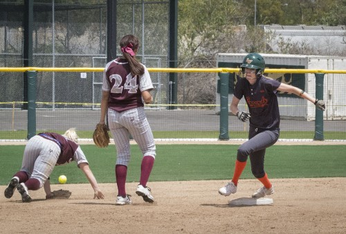 La Verne senior left fielder Laura Olson rounds second base as Redlands second baseman Amanda Clark tries to save a ball missed by shortstop Vicki King in the bottom of the sixth inning Saturday. La Verne's next doubleheader is noon Saturday at Pomona-Pitzer. / photo by Helen Arase