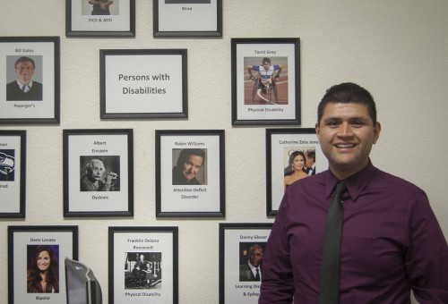 Leo Barrera, the new coordinator of disabled student services, hired this spring, says he looks forward to adding photos of students who have graduated from La Verne to his wall of successful people with disabilities. / photo by Katie Madden