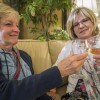 "Cheryl Himebauch, a San Dimas resident, and Nancy Burton, a La Verne resident, cheer to a good night in Gina T Home at the ""Sip of La Verne"" Wine Walk last Saturday. The wine tasting provided ticket holders with a map, 12 tasting tickets and a glass. Patrons chose from 23 businesses serving wine in downtown La Verne. Each stop provided food to complement their wine. Sanders Towing participated as well by offering free towing within seven miles, if needed, to get patrons home safely. / photo by Helen Arase"