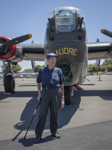 Chuck Neilson, a WWII veteran, stands in front of a B-17 at Brackett Airport during the Wings of Freedom Tour event Monday. / photo by Keenan Gilson