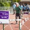 Paul Alvarez, director of the athletic training program, sprints the final lap of the Relay for Life Sunday. The American Cancer Society held the event Saturday and Sunday on Ortmayer Stadium's track. The race lasted 24 hours as participants either ran or walked the whole time. A total of 5,134 laps were completed during the event. / photo by Jessica Harsen