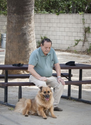 John Giambalvo and his dog, Charlie, take a break at the Claremont Pooch Park as they wind down from a game of fetch. The leash-free park brings dogs from around the area together, welcoming all with free tennis balls and dog water fountains. / photo by Veronica Orozco