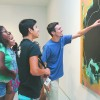 "Brandon Czworniak, freshman administration major, Julian Vega, freshman kinesiology major and Atianna Williams, freshman theater major, discuss the texture of the acrylic paint on a canvas. The untitled painting by artist Phil Argent was featured in the reception of ""Pictures of Everything"" at the Harris Gallery on Tuesday. The exhibition features abstract paintings of 10 artists and it will be open to the public until Oct. 30. / photo by Mariela Patron"