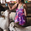 For $3 visitors can buy livestock feed pellets in paper cups at the Los Angeles County Fair. Cal Poly Pomona student Marcella Mendieta of Upland feeds the sheep at the petting zoo. These animals were selected for the attraction due to their lack of top teeth, making them safer to feed. The sheep, goats and cows can be found in the farm section. The Fair is open Wednesdays through Sundays until Sept. 28. / photo by Megan Peralez