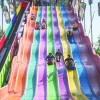 Children each paid $2 to ride the rainbow inspired Euro Slide at the Los Angeles County Fair on Labor Day. The annual Fairplex event opened last weekend and will remain open until Sept. 28. The fair also opened three new exhibits for the 2014 season. / photo by Michael Saakyan