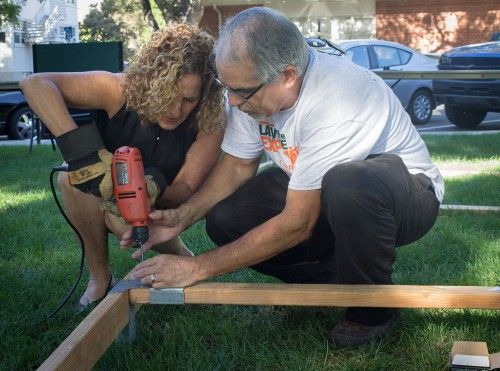 President Devorah Lieberman drills a piece of wood to build the Sukkah with the help of Director of Multicultural Services Daniel Loera. The Hillel Jewish Club built a Sukkah during the one week Jewish holiday of Sukkot on Wednesday at Sneaky Park. During the holiday of Sukkot a Sukkah is built out of wood with three walls covered in green fabric and is blessed by a cantor. The Sukkah will stand throughout the holiday for people to meditate and be at one with God and themselves. / photo by Michael Saakyan