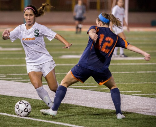 Junior midfielder Carlee Chien attempts to make it past Pomona-Pitzer's sophomore defender Jamie Kerester, in hopes of breaking the tie and winning the game during the first overtime of Saturday's game at Ortmayer Stadium. Although there were many opportunities to score a goal, both teams battled it out until the end of the second overtime. Neither team scored, ending the game in a draw, 1-1. The Leopards take on Claremont-Mudd-Scripps at 11 a.m. Saturday in Claremont./ photo by Amanda Duvall