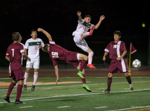 La Verne sophomore Harim Coronado volleys the ball away from Redlands Bulldogs senior Charles Izydorek after a goalie throw during the second half of Saturday's game. The Leopards beat the Bulldogs, 2-1, at Ortmayer Stadium. See story on page 11./ Photo By Sonora Hernandez