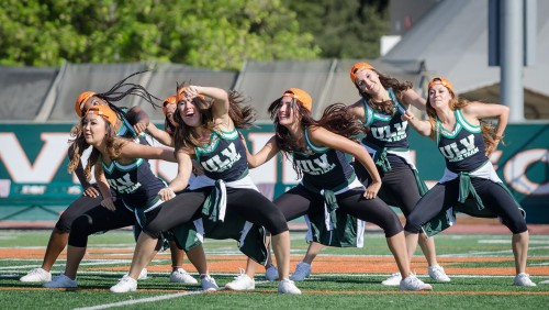 The La Verne Dance Team performs during half time at the Homecoming football game against Redlands. The group – including Ashley Hernandez, Diana Ibarria, Miranda Ramirez, Sarah Oishi, Hayley Kurisu, Shantall Segura, and Jasmine Marchbanks – also assisted with the announcement of Homecoming king and queen. The Dance Team's mission is to promote school spirit through performances at sporting events and other campus events. They dancers perform a variety of genres of dance but their two main styles are jazz and hip-hop./ photo by Emily Bieker