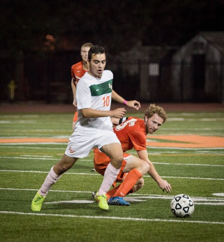 La Verne sophomore forward Nathan Gonzalez pushes his way past Caltech junior defender Teo Wilkening Monday in a drive that was later blocked. The first two goals were scored in the first seven minutes of the game by Gonzalez and sophomore midfielder Jaime Moreno. The Leopards crushed the Beavers, 6-0 at Ortmayer Stadium. / photo by Megan Peralez