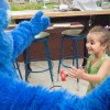 Fatima Khawaja, age 3 from La Verne, meets Cookie Monster while frosting cookies at Pappas Artisanal on Halloween. Pappas Artisanal was one of the many shops in Downtown La Verne that opened its doors to trick-or-treaters from 3 p.m. to 6 p.m. / photo Mariela Patron
