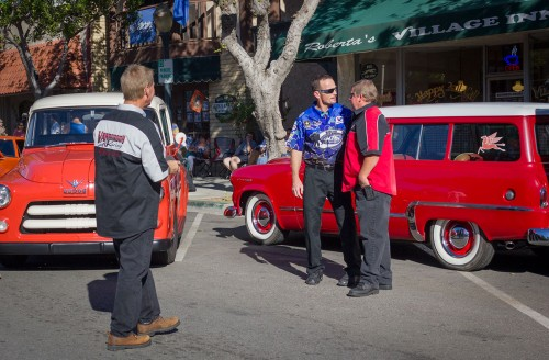 """Jack Beckman talks with Gary Spears from Rancho Cucamonga after Jack Patten took photos of them together during the National Hot Rod Association Fan Fest Saturday in Downtown La Verne. Beckman is a drag racer competing professionally in the NHRA funny car races and is also known as """"Fast Jack."""" / photo by Kaung Myat Tun"""