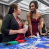 Sigma Kappa members Laura Tijerina, senior, and Kelsi Robinson, sophomore, chat about dealing blackjack at the fourth annual Sigma Kappa Casino Night in the Campus Center Ballroom Nov. 22. Casino Night is a philanthropy event to raise money for the Sigma Kappa Foundation, which provides scholarships, allocates funds to philanthropy activities and provides funding for Alzheimer's disease research. Sigma Kappa raised $4,512 at Casino Night. / photo by Sonora Hernandez