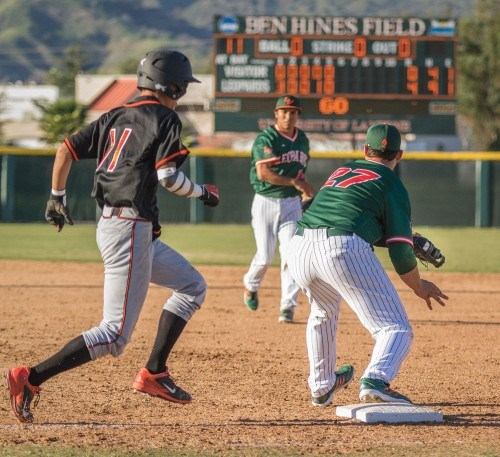Caltech junior center fielder Daniel Chou is thrown out at first base by La Verne junior second baseman Aaron Orona to junior first baseman Ben White in the top of the sixth inning Friday at Ben Hines Field at Campus West. The Leopards harassed the Beavers from the first inning, winning 12-1 at the bottom of the eighth, after the mercy rule was enforced. / photo by Helen Arase