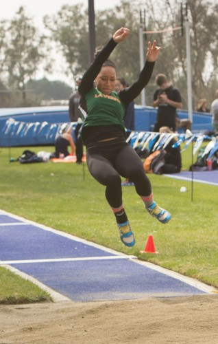 Junior Jessica Reeves jumps for 4.16m in the long jump event at the Pomona-Pitzer All-Comers Saturday at Strehle Track. She came in 13th place./Photo by Celene Vargas