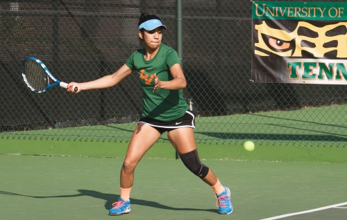 Junior Andrea Madrigal returns the ball to Brandeis opponents junior Maya Vasser and freshman Danielle Simms. Madrigal and partner freshman Janae Chinn won the match 8-4. No. 15 La Verne defeated the Judges, 7-2, Saturday at the Claremont Club. / photo by Bailey Maguire