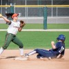 At the top of the fifth inning, La Verne senior shortstop Danielle Vela throws out Ithaca freshman second baseman Allie Colleran at second base and tries to turn the double play in game one of the doubleheader. The Leopards fell short, 4-2, in game one, but came back to detonate the Bombers, 7-1, in game two, Monday at Campus West./ photo by Sara Flores
