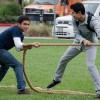 Elias Maldonado, sophomore computer science major, and Juan Ornelas, sophomore business administration major, participate in a round of tug of war against their friends Wednesday for a chance to win a Fitbit Flex, a small wrist pedometer that tracks the user's movements among other functions. The Get Active event was in the South Quad and hosted by CAB. Along with sandwiches and Jamba Juice, participants were provided opportunities to engage in activities such as Frisbee toss, hula hooping and tug of war. / photo by Alexandra Arkley