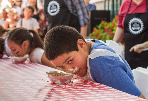Nine-year-old Daniel Lucero from Pomona comes up from his pie for a moment to eye his competition in the pie eating contest for the 7-10 age group at the third annual Claremont Village Pie Festival March 14. Lucero won the contest. This was his family's first time attending the festival and his first time in any sort of eating competition.  / photo by Celine Dehban