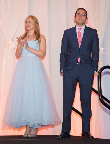 Alina Rozwadowska and Julian Mininsohn wait to deliver speeches at Saturday's Scholarship Gala. Rozwadowska is a recipient of the Dean's Scholarship from the College of Business, and Mininsohn is the inaugural recipient of Rob Fukuzaki's Heads Up Youth Foundation Scholarship. / photo by Helen Arase