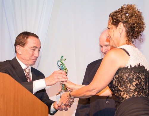 University of La Verne President Devorah Lieberman presents Richard Lewis of the Lewis Group of Companies with the 2015 President's Award, as Roger Lewis watches. Richard Lewis gave the honoree remarks, beginning with thanking his wife Rebecca. Richard Lewis has been on the University of La Verne Board of Trustees for the last 15 years. The Scholarship Gala '15 was hosted at the Sheraton Conference Center Saturday night. / photo by Helen Arase