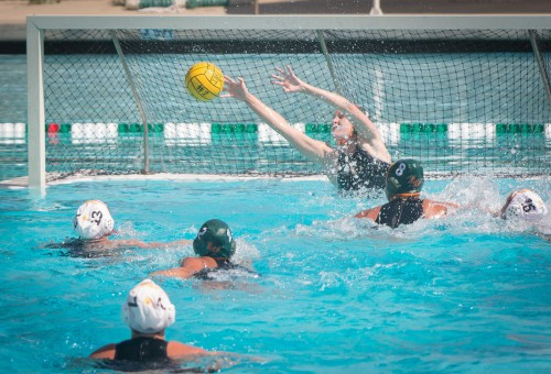 La Verne freshman goalkeeper Hailey Westwood barely prevents a goal by Claremont-Mudd-Scripps, which they quickly rebounded and scored. CMS continued to pounce on the Leopards throughout the game, ending the Southern California Intercollegiate Athletic Conference opener, 11-3, in the Athenas' favor Saturday at La Verne Aquatics./ photo by Daniel Torres