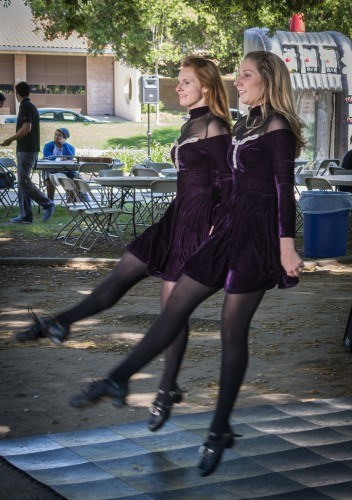 "Carrol Coyne and Meredith Lyons performed an Irish folk dance as a part of the ""Luck of the Leos"" event on March 25 in Sneaky Park. Coyne and Lyons have been dancing for about 17 years. Lyons founded the Lyons Academy of Irish Dance in San Pedro in 2010. / photo by Daniel Torres"
