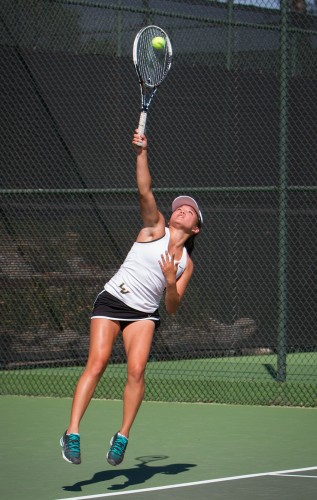 Freshman Janae Chinn and doubles partner junior Andrea Madrigal won their doubles match against Claremont-Mudd-Scripps, 8-6, Saturday at the Claremont Club. The Athenas' crushed the Leopards in the singles matches, resulting in an overall loss for La Verne, 8-1./ photo by Celine Dehban