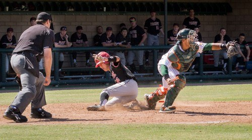 Pacific University freshman third baseman Cole Kanazawa scores in the top of the seventh inning during game four of the series Sunday at Ben Hines Field, as La Verne sophomore catcher Nikko Williams catches the ball too late. The Boxers defeated the Leopards with a final score of, 11-6. / photo by Helen Arase
