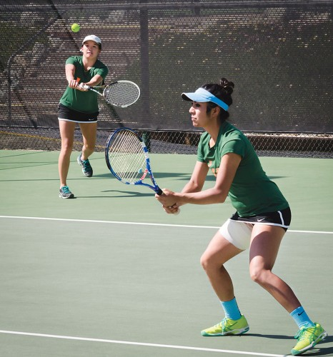 La Verne sophomore Janae Chinn returned the ball to continue a short rally near the end of the last set in their doubles match. Chinn and teammate junior Andrea Madrigal skinned the Beavers, 7-2, Friday at the Claremont Club. / photo by Alexandra Arkley