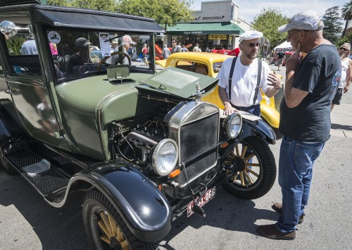 James Skalicky, owner of an early Ford Model T and professor of psychology at Citrus College, discusses the car with fellow car enthusiast Bob Shears, a University of La Verne alumnus and middle school teacher in the San Gabriel Valley. Classic cars from all eras lined C and D streets Saturday for the Cool Cruise Car Show in downtown La Verne. / photo by Daniel Torres