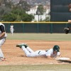La Verne junior designated hitter Daniel McDonnell dives back to first base after attempting to steal second during the bottom of the fourth inning. The Leopards lost to the Occidental Tigers in game one of the doubleheader, 5-2, after 14 innings Saturday at Ben Hines Field. Then they pounced right back in game two, winning the game, 11-4. / photo by Celene Vargas