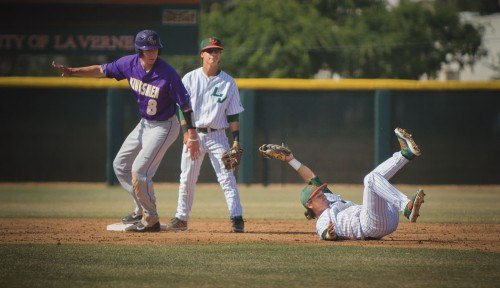 With no outs in the top of the fourth inning, junior second baseman Aaron Orona fielded the ground ball that was hit to right field, holding Cal Lutheran's Davey Cascicola on second base. Friday's game at Ben Hines Field ended with La Verne winning 5-4. / photo by Jerri White