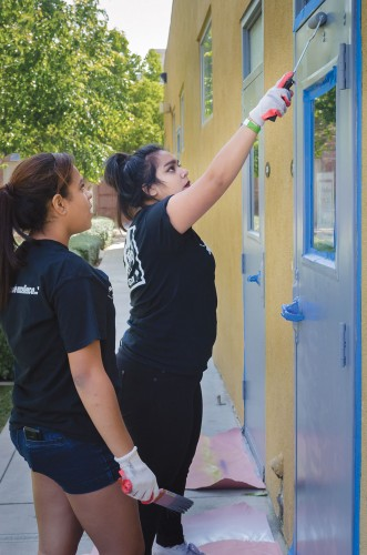 Volunteers Natalie Mendoza and Amber Lopez help paint the School of Art and Enterprise in Pomona Saturday. This was one of the nine volunteer activities that started at 8 a.m., as part of Pomona Beautification Day. The event was designed to bring volunteers of all ages to help local organizations with their various city projects. Those helping out at the School of Arts and Enterprise painted doors and walls and cleaned up across the campus. / photo by Alexandra Arkley