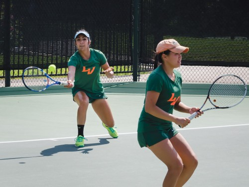 Andrea Madrigal and Janae Chinn face off against Pomona-Pitzer's Sagehens Saturday. One hour into the game with the Sagehens leading 7-2, Madrigal returned a volley, which started with her serve, to continue a small rally. Madrigal and Chinn put up a fight against their opponents but the Sagehens flew over the Leopards, 8-3. / photo by Alexandra Arkley