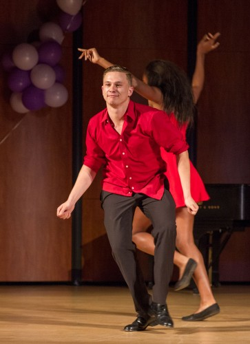"Junior Zachary Robertson, from Sigma Alpha Epsilon, does a Latin dance routine with sophomore Sigma Kappa member Kelsi Robinson at Sigma Kappa's Maine Man pageant April 30 in Morgan Auditorium. After judging and voting, Robertson was crowned as Sigma Kappa's Maine Man out of twelve contestants, as he demonstrated the sorority's core values of personal growth, loyalty, friendship and service. This was the first year Sigma Kappa held the ""Maine Men"" contest, raising more than $500 for the Maine Sea Coast Mission and the Sigma Kappa Foundation. photo by / Celine Dehban"