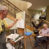 Local artist Charles Fogg paints a portrait of Charles Davis, a 1948 University of La Verne alumnus, May 1 at Hillcrest Retirement Community. Hillcrest opened a gallery for the residents to showcase their creative works. The gallery included paintings, photography, knitting and sculptures. Fogg included two portraits that he had painted of some residents. / photo by Bailey Maguire