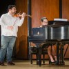 """Vijay Gupta (violin) and assistant professor of music Grace Zhao (piano) warms up in Morgan Auditorium before an informal performance May 1. Gupta earned his master's degree in music from Yale at age 19, then joined the Los Angeles Philharmonic Orchestra. Since then he has founded a nonprofit performing group called Street Symphony. He was also a TED speaker. In January he was presented with the honorary doctorate of humane letters by the University of La Verne. He opened Friday's concert with Johann Sebastian Bach's """"Gavotte en rondeau"""" of Violin Partita No. 3. / photo by Alexandra Arkley"""