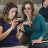 Cindy Gaytan, special events coordinator, and Debbie Hughes, executive assistant to the chief financial officer, answer a live survey at the University Identity and Website Redesign Project input session in the Campus Center Ballroom Monday. The session was led by representatives from the Ohio-based marketing agency Ologie, which has been hired to create a brand that accurately represents La Verne. The representatives asked faculty and staff to anonymously vote online with their opinions of what makes ULV special. Ologie will hold additional input sessions for smaller focus groups like students and different administrative units. / photo by Celene Vargas