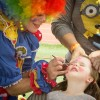 Callie Thomason, 3, gets her face painted as a fairy princess by Penelope the Clown during Relay For Life Saturday at Claremont High School. Penelope was a part of Team Stillwell, participating for a second year. The team was formed by University of La Verne employees in memory of former Director of Special Projects, Judith Stillwell, who died of brain cancer in 2014./ photo by Jolene Nacapuy
