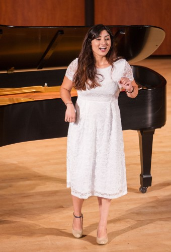 """Sarah Alonzo, junior music major with a minor in biology, performed at the Fridays At Noon Student Recital in Morgan Auditorium May 15. Alonzo did three different numbers, and the last song she soloed, """"I Bought Me a Cat"""" by Aaron Copland, is an old children's song, where she had to sing animal noises. / photo by Celine Dehban"""