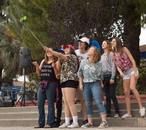 "The San Dimas High School Drama club performs ""Route 66"" at the second annual San Dimas High School Car Show on Saturday. Brooklyn Boyd, Miranda Rodriguez, Daniel Tubbs, Joshua Penny, Nikki Yates, Joe Oresman, Sean Goldsworthy and Austyn Haley pose for a selfie with a selfie stick during their performance. See story on page 3./ Photo by Bailey Maguire"