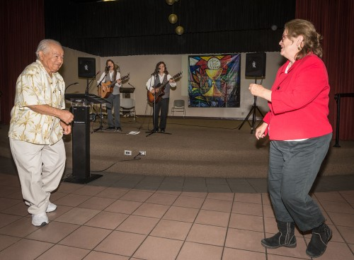 """Sixto Cervera, 90, dances with Connie Weir to """"La Bamba"""" performed by the Licata Brothers, Tony and Jimmy, at an ice cream social Saturday sponsored by Our Lady of Assumption in Claremont. Cervera is the grandfather of the Licatas and Weir is an organizer. The event raised funds for Christian and Muslim victims of Boko Haram in Nigeria. / photo by Daniel Torres"""