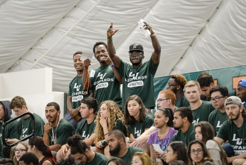 Student-athletes of the University of La Verne football team, junior safety George Evans III, sophomore safety Michael Hill and junior running back Justin Manson, cheer on their incoming freshman teammates during the convocation ceremony, as they are welcomed into the University. / photo by Helen Arase