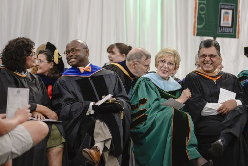 Associate Vice President of Academic Support and Retention Services Adeline Cardenas-Clague and Dean of the School of Arts and Sciences Lawrence enjoy the events during Loren Dyck's convocation speech on September 2, 2015. Dyck asked the audience to share something about themselves to the person at their side. To their left, Interim Dean of the LaFetra College of Education Barbara Poling and Avedis Kechichian, Chief Financial Officer do the same. Dyck then asked the audience if they were interested in the information each person learned./ photo by Helen Arase