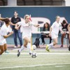 Senior midfielder Cassidy Schweiger leads the charge, in an attempt to score another goal with the assist of senior midfielder Maribel Duran and junior forward Alexa Smith. The women's soccer team dominated UC Santa Cruz, with a lead of 3-0 in the first half of the game./Photo by Terrence Lewis